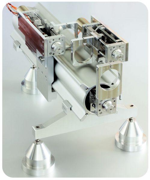 Système de micro positionnement d'optique sous vide